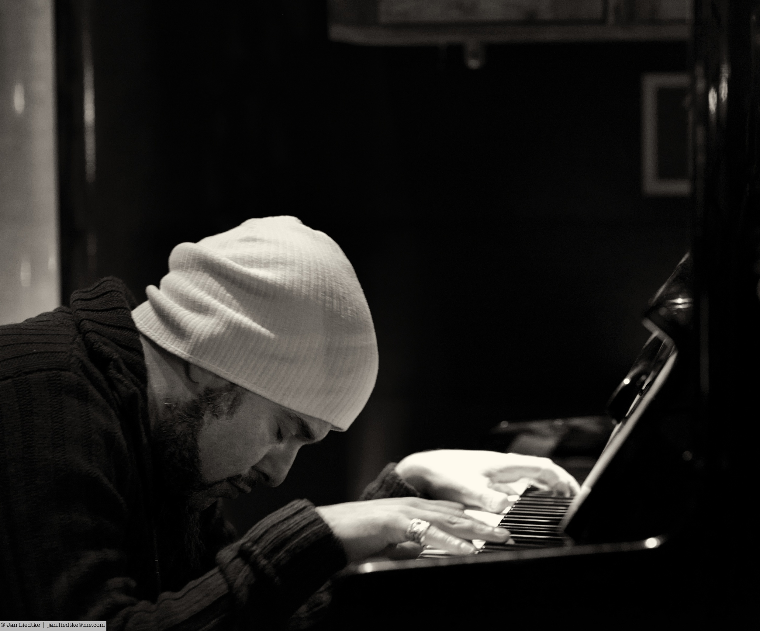 """Pianist Reza Aghamir is in the moment and sits in a """"Glenn Gould position"""" when he paints the musical picture for the singers."""