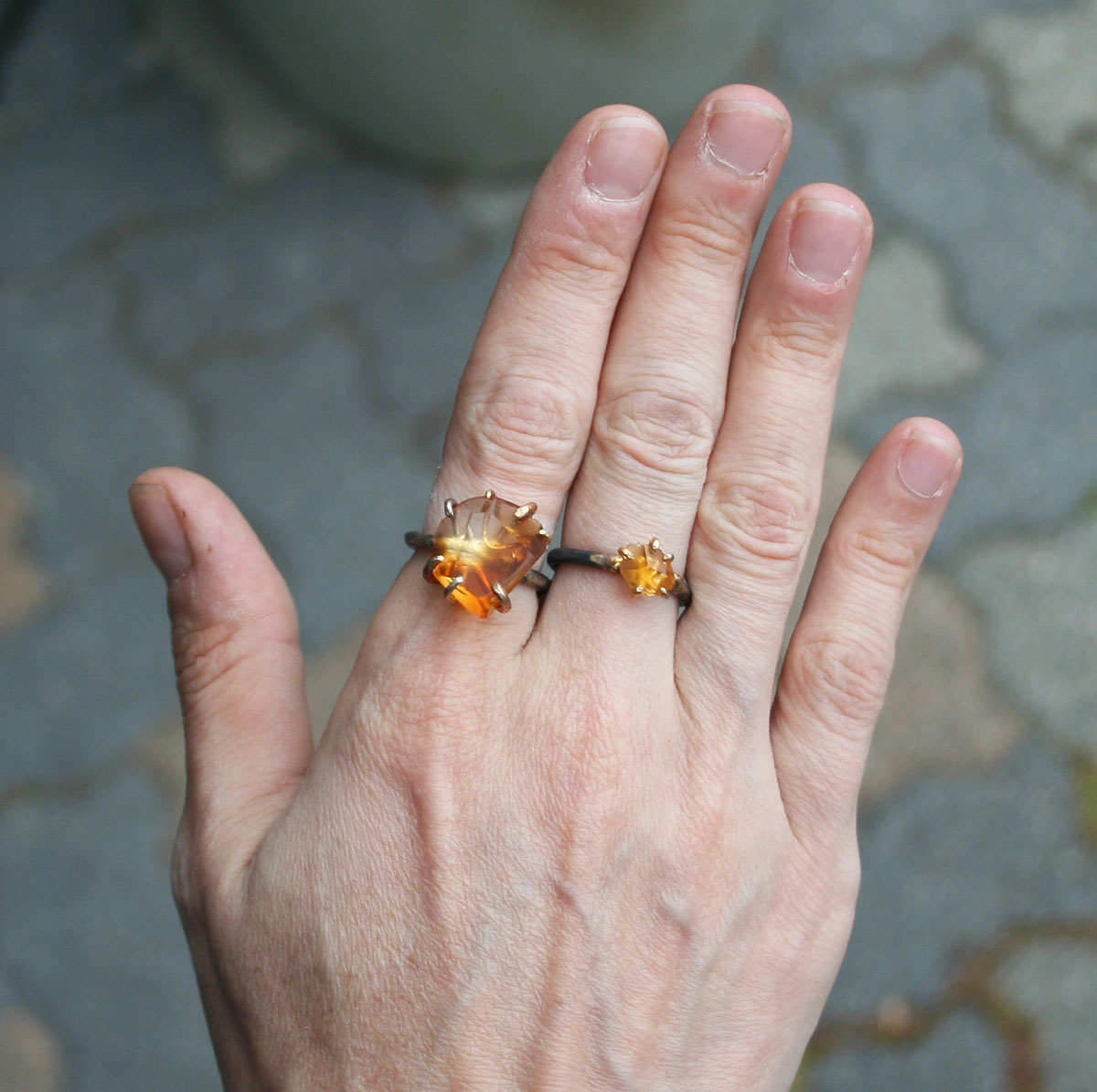 Stone Size - Cut-stone rings are typically sold as either small or large. Small stones used in rings range from 3-6mm in diameter and large rings range from 8-12mm. See the photo above for a good visual of the difference.