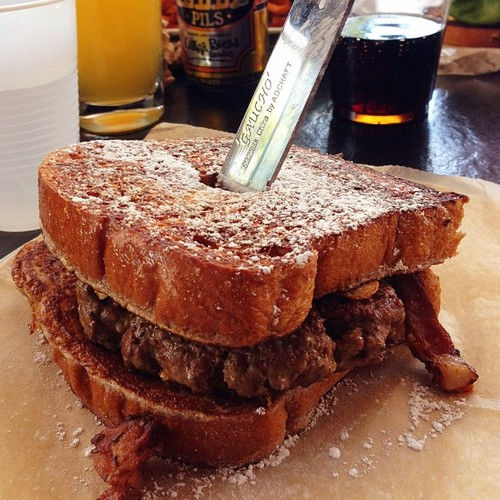 House-made bourbon ham, Pecan-smoked bacon, Over-easy fried farm egg, Brie, Brioche French Toast, Burger