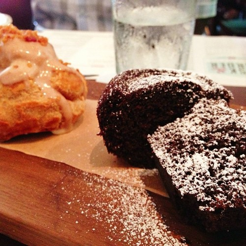 Bakeshop on a board. Chocolate chip muffin, turnover, pretzel bun, and profiterole