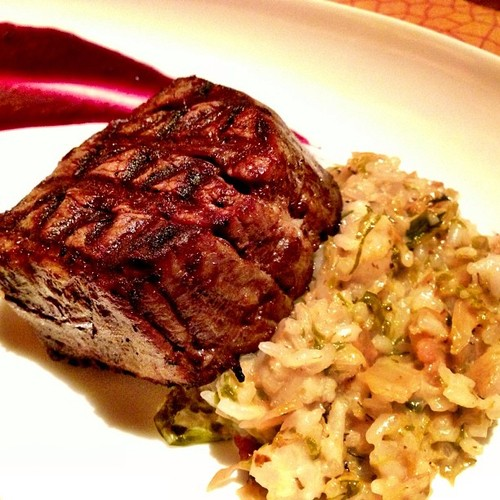 GRILLED BEEF FILET Brussel sprouts & smoked bacon risotto, huckleberry demiglace
