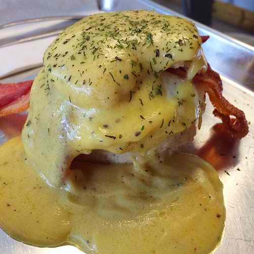 Buttermilk biscuit, egg over-easy, apple-wood smoked bacon, crispe-fried green tomato, black pepper hollandaise