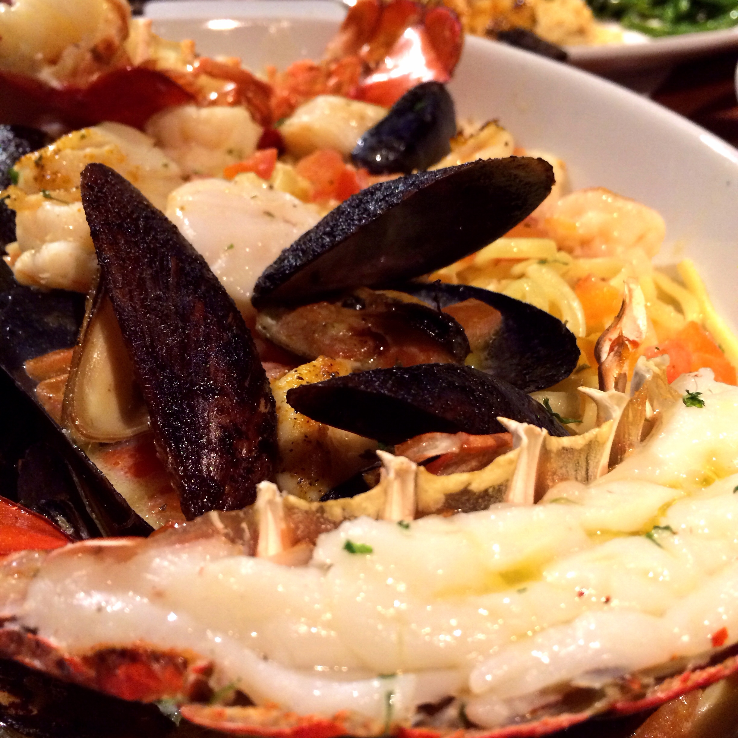 Bar Harbor Lobster Bake. A roasted split Maine lobster tail, tender shrimp, sea scallops, mussels and linguini in a garlic and white wine broth