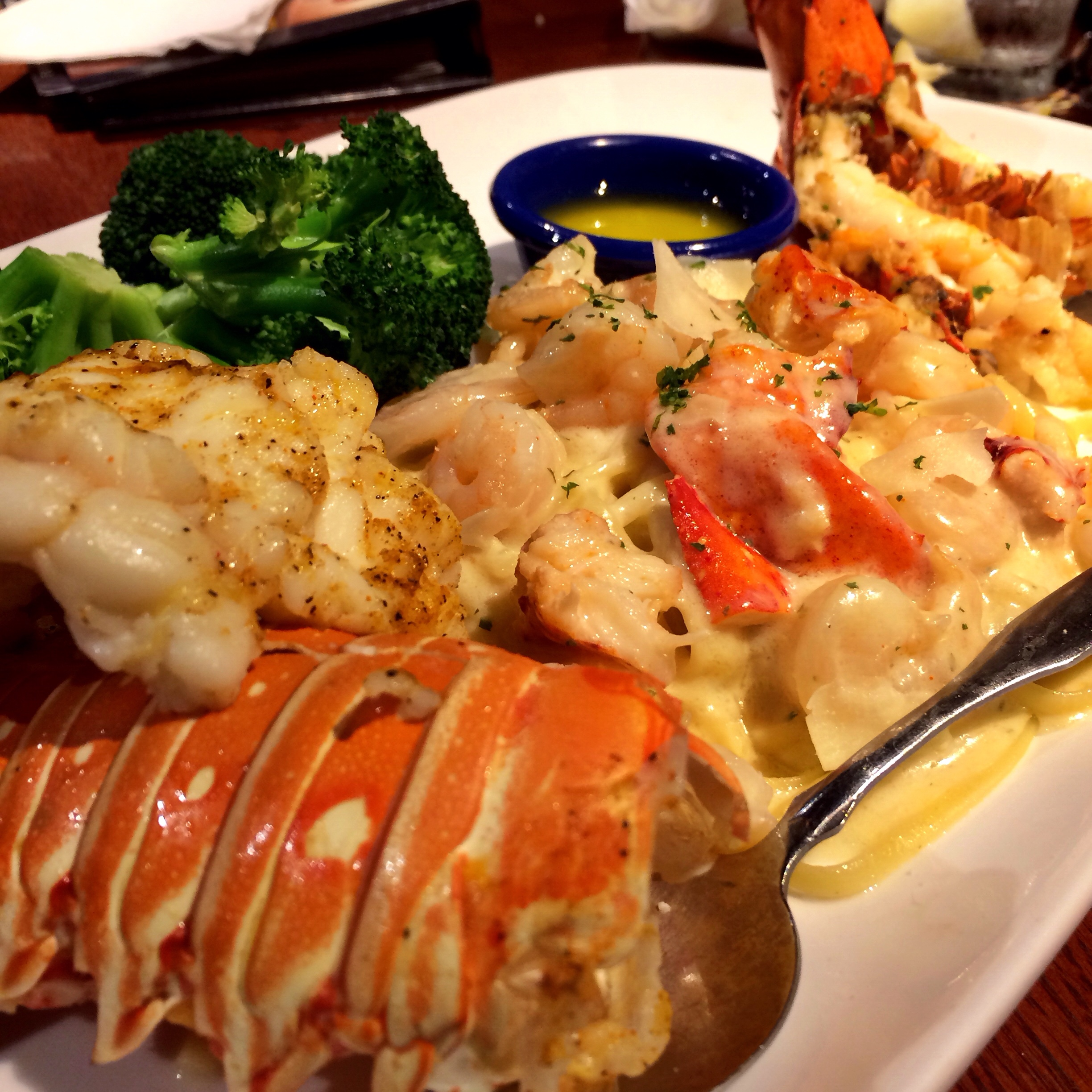 Lobster Lover's Dream. A succulent rock lobster tail and sweet split Maine lobster tail, roasted and served with lobster-and-shrimp linguini Alfredo