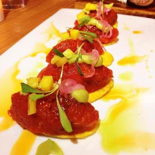 Spicy tuna, tostone chips, avocado puree, tropical mango relish