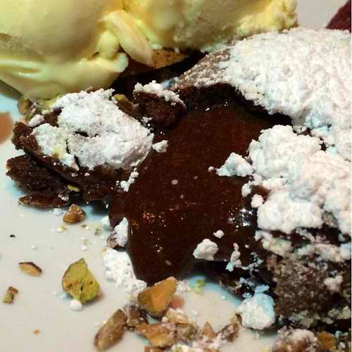 I did not realize the camera was not recording when the chocolate was oozing out :( CHOCOLATE LAVA CAKE @ Fleming's rich chocolate cake with a molten center of belgian chocolate, served with vanilla ice cream and chopped pistachios
