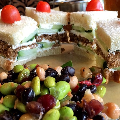 Cucumber and cream cheese served classic tea-sandwich style: triple-decker white and wheat triangles sans crusts.