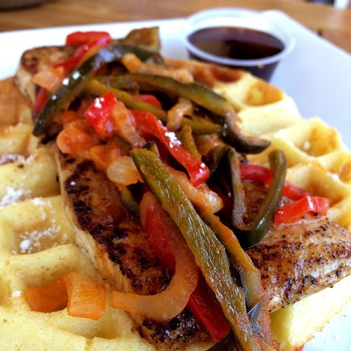 Crispy fried fish over a Belgian style bacon waffle
