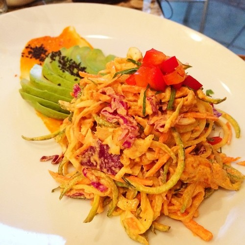 PAD THAI (@cafe118degrees) tamari – glazed cashews, zucchini and carrot noodles, chopped avocado, purple cabbage, red pepper, Tossed in Sesame almond sauce, drizzled with savory red pepper glaze