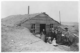 Hoglunds built-up dugout may have looked something like this. They extended the stone walls upward, installed a ridge pole to anchor the roof, and sodded the slopes to keep out the rain and snow.