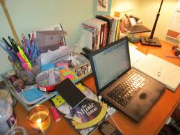 This could easily be my desk--covered with miscellaneous everything, light coming in from the right, and a candle on the left. Writers can be neat and orderly too, or like me, some of both.