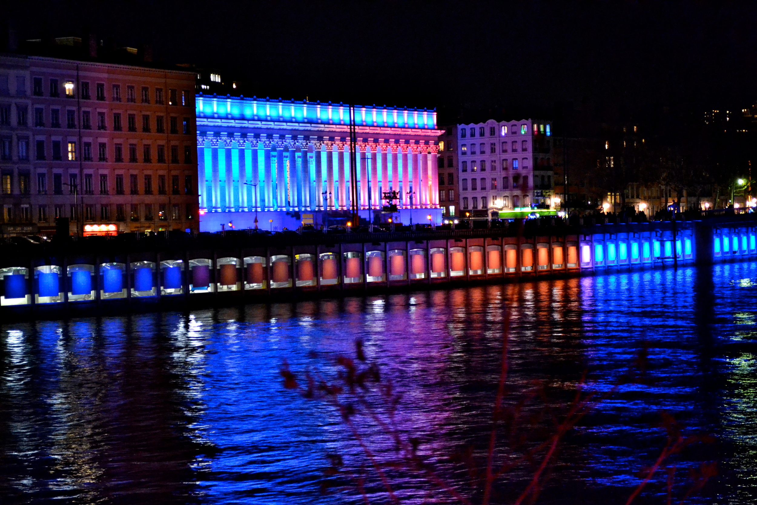 An illuminated building set to a classical music soundtrack