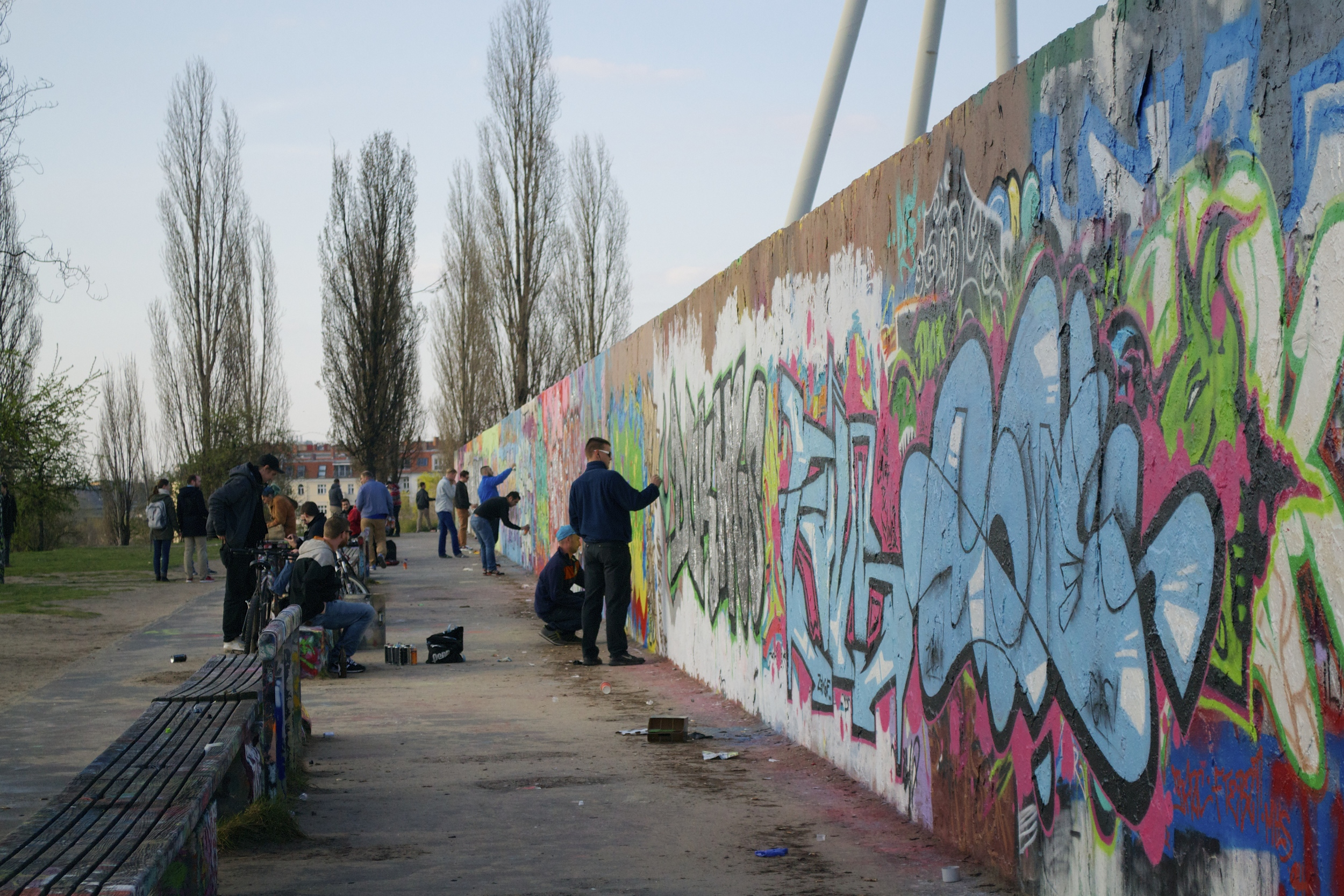 Graffiti artsits at work at the Mauerpark.
