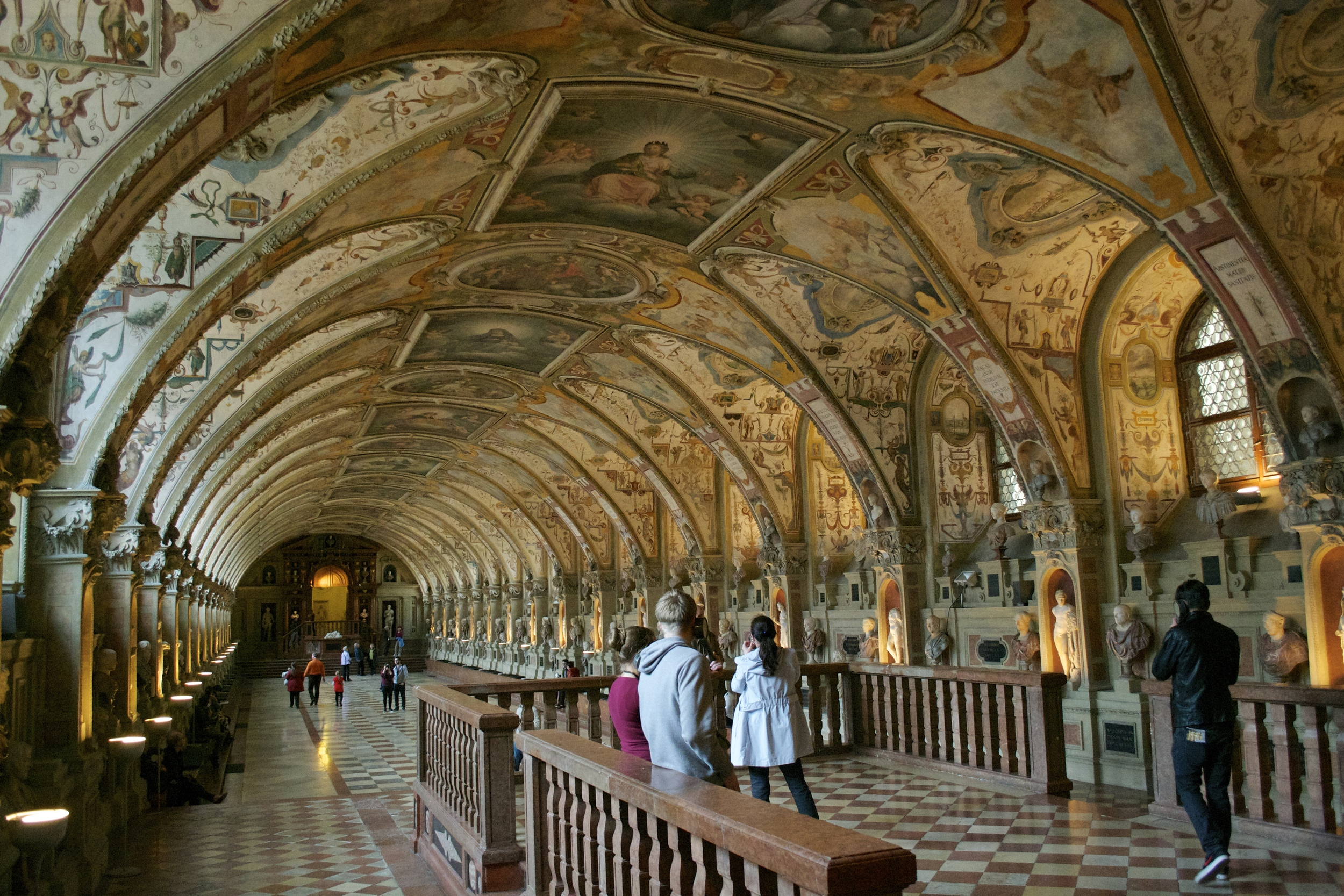 The Residenz's Antiquarium, full of classical busts and painted archways.