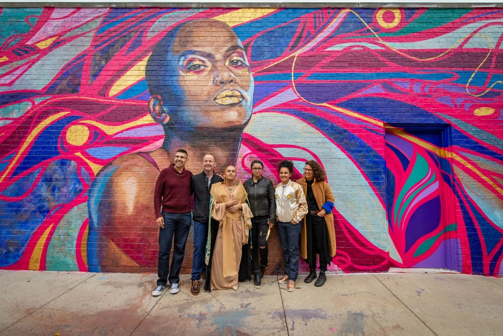 """..a portrait of Chicago-based Kiam Marcelo Junio, a holistic healer and interdisciplinary artist. The piece is by artists Sandra Antongiorgi, Andy Bellomo, and Sam Kirk—and the first in a series of LGBTQ tribute murals."""