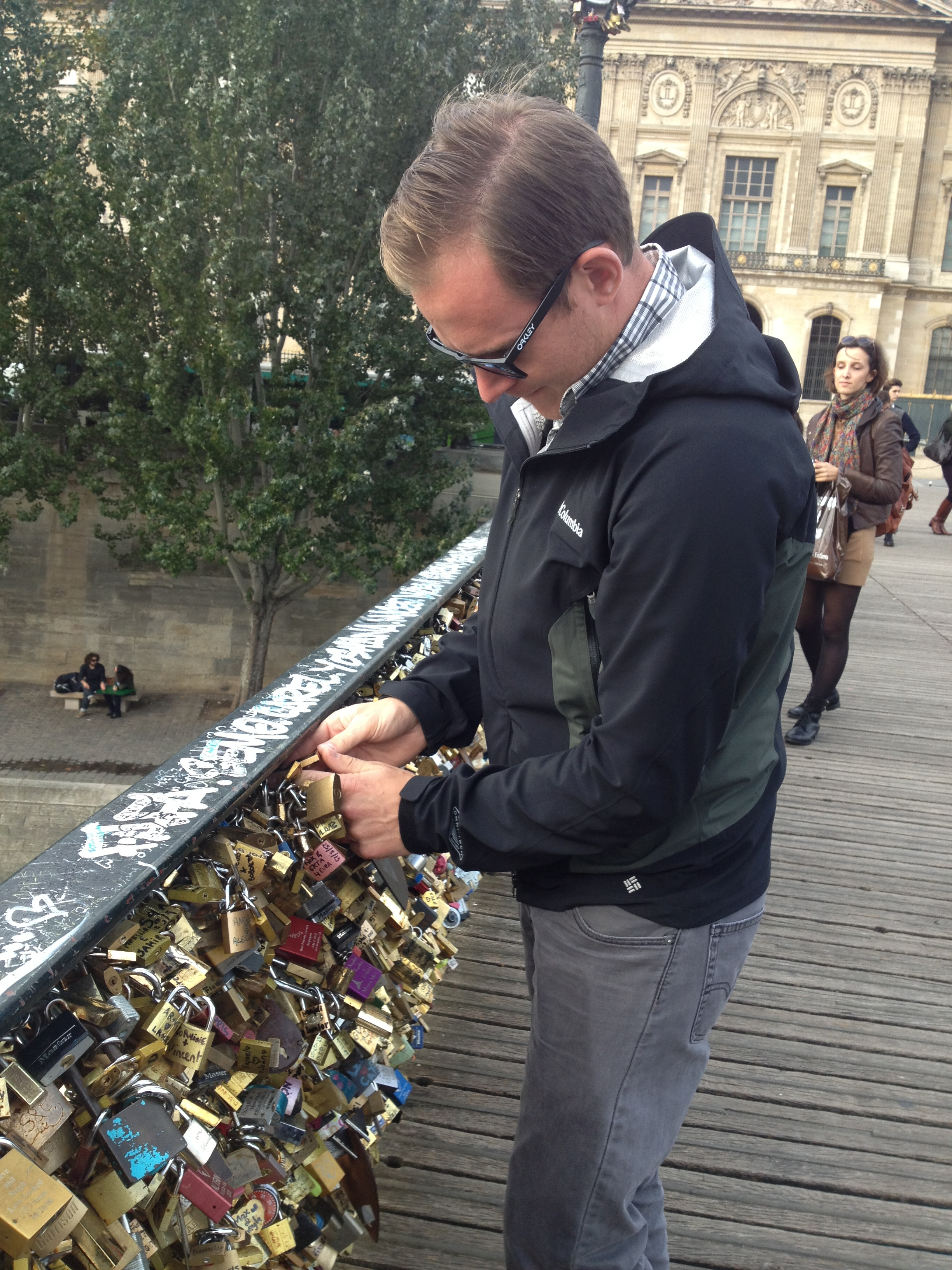 ryan attaching our love lock to the bridge