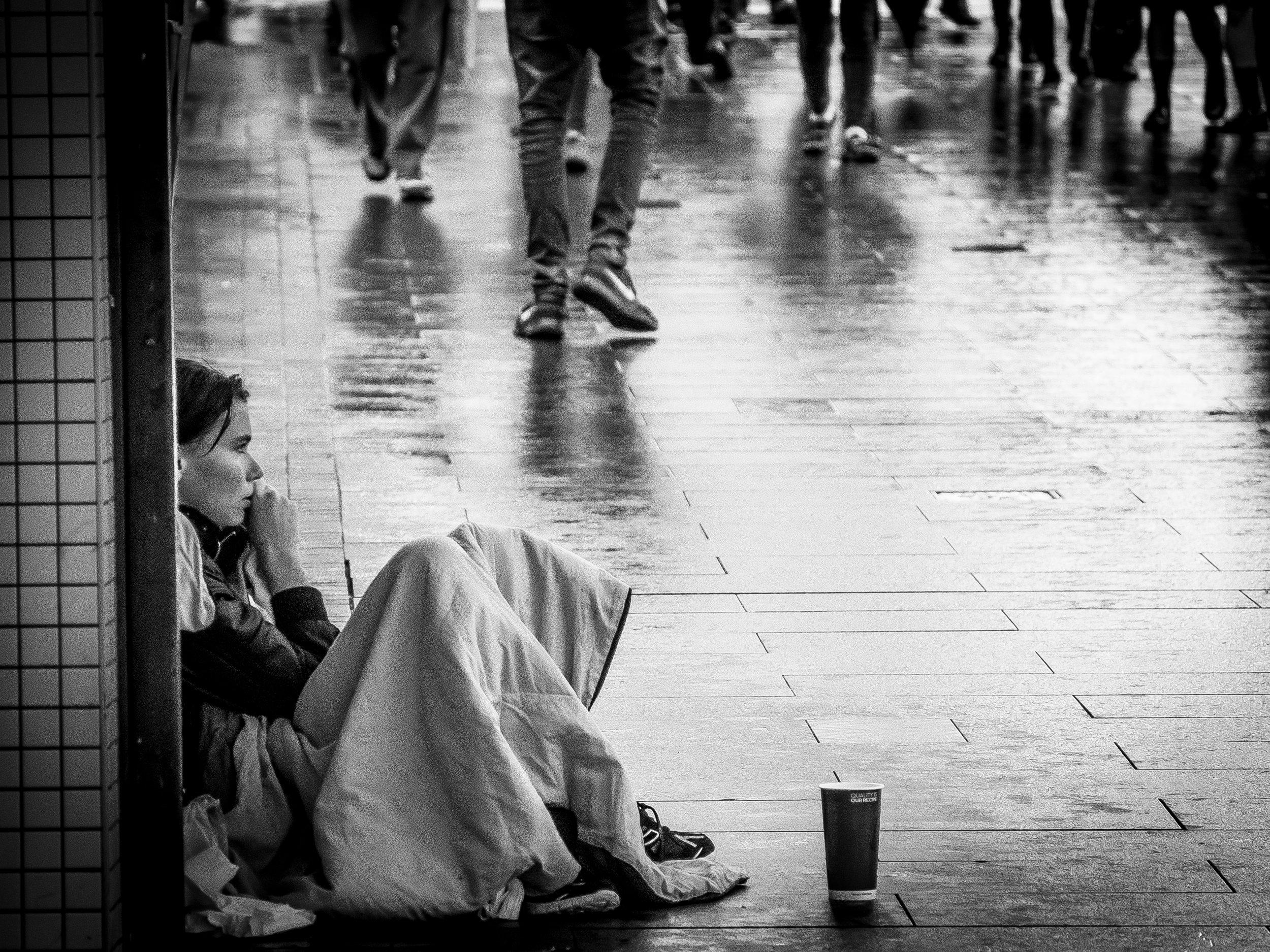 Homeless girl on Queen St - Auckland CBD.jpg