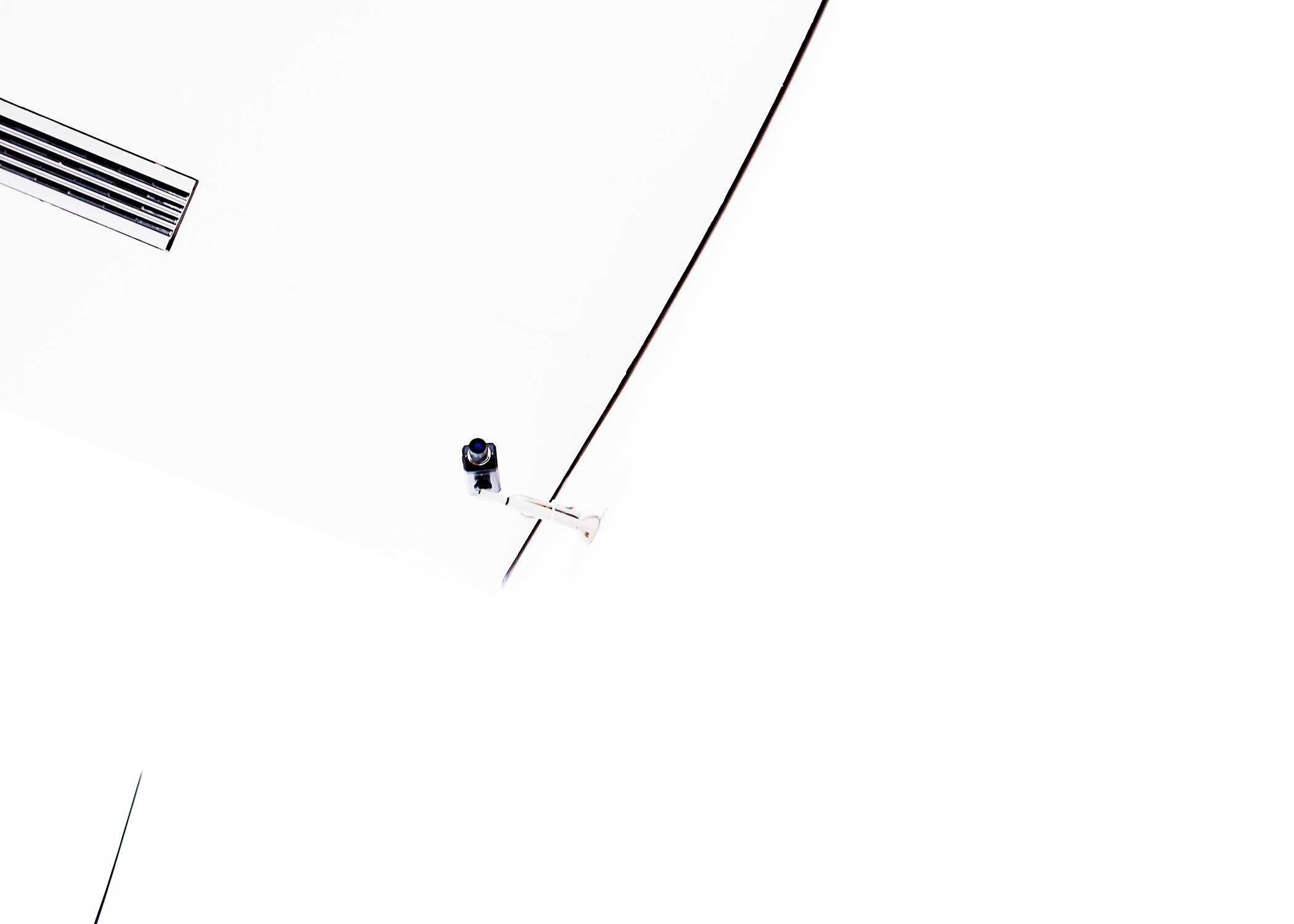 security-camera-white-space-minimalist-Matthew-Coleman-Photography