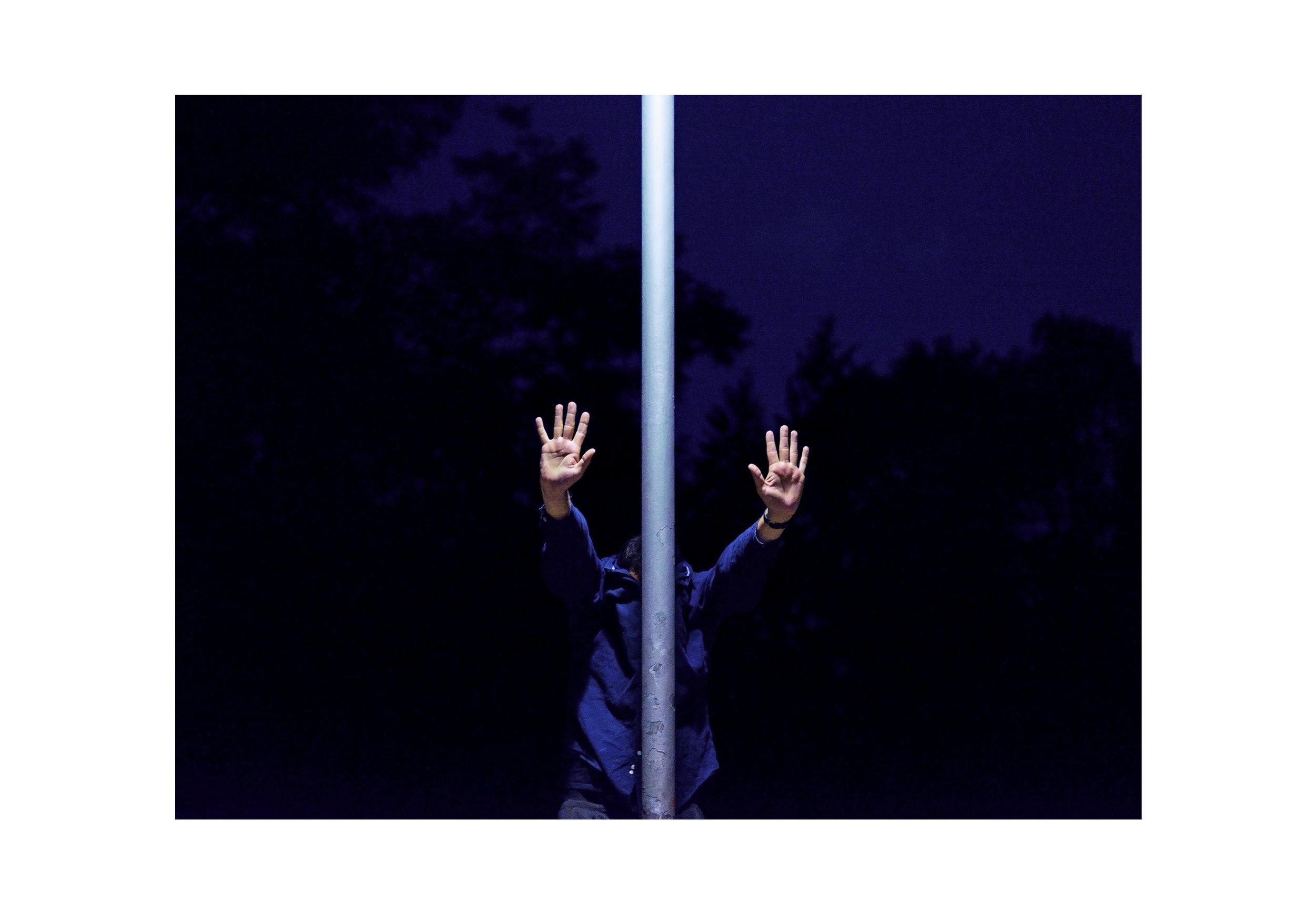 Marcel-Eichner-hands-pipe-hiding-Berlin-night-Matthew-Coleman-Photography.jpg