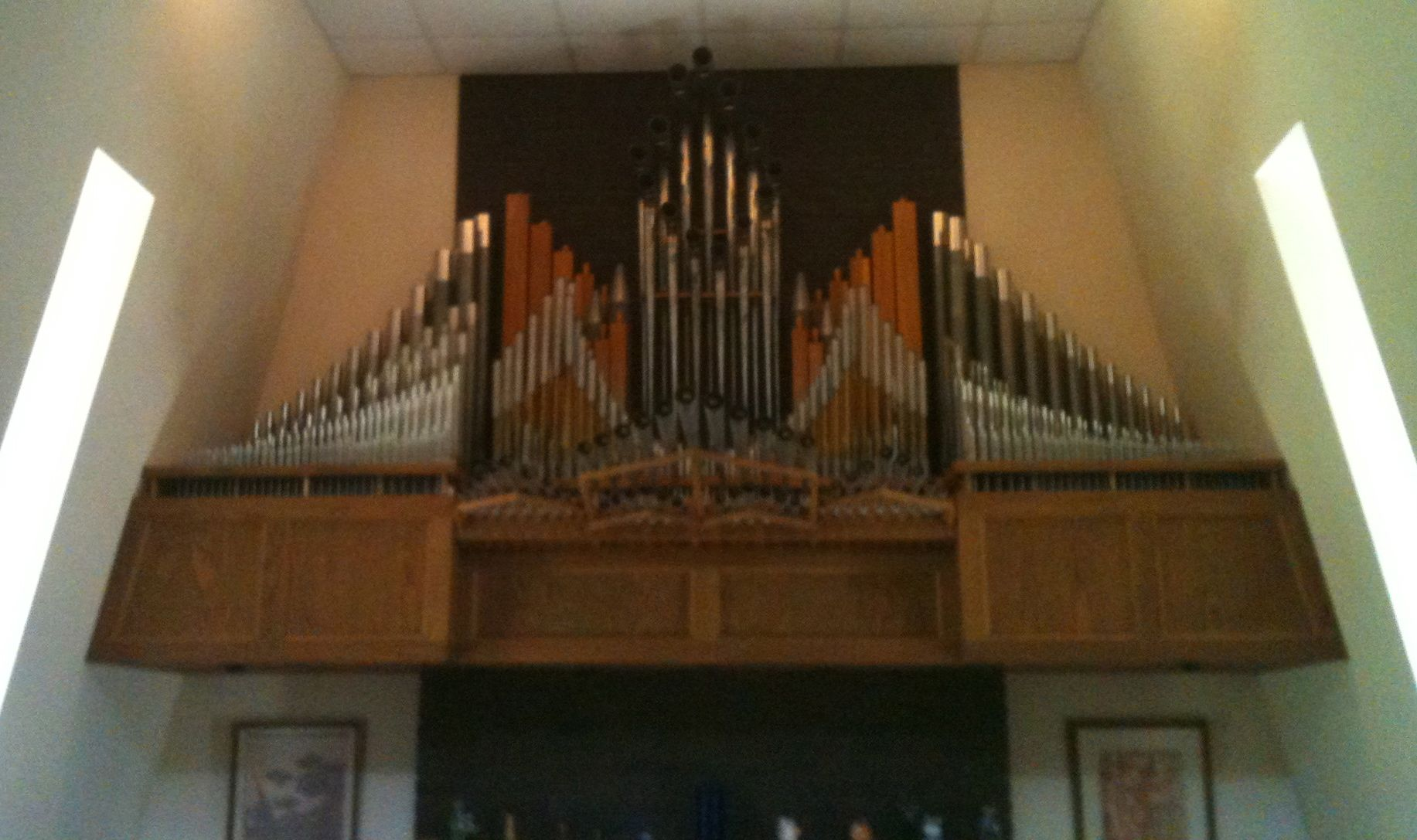 These are the pipes that would play during a fanfare (bugle and horn sounds), which protrude from the fireplace surround.