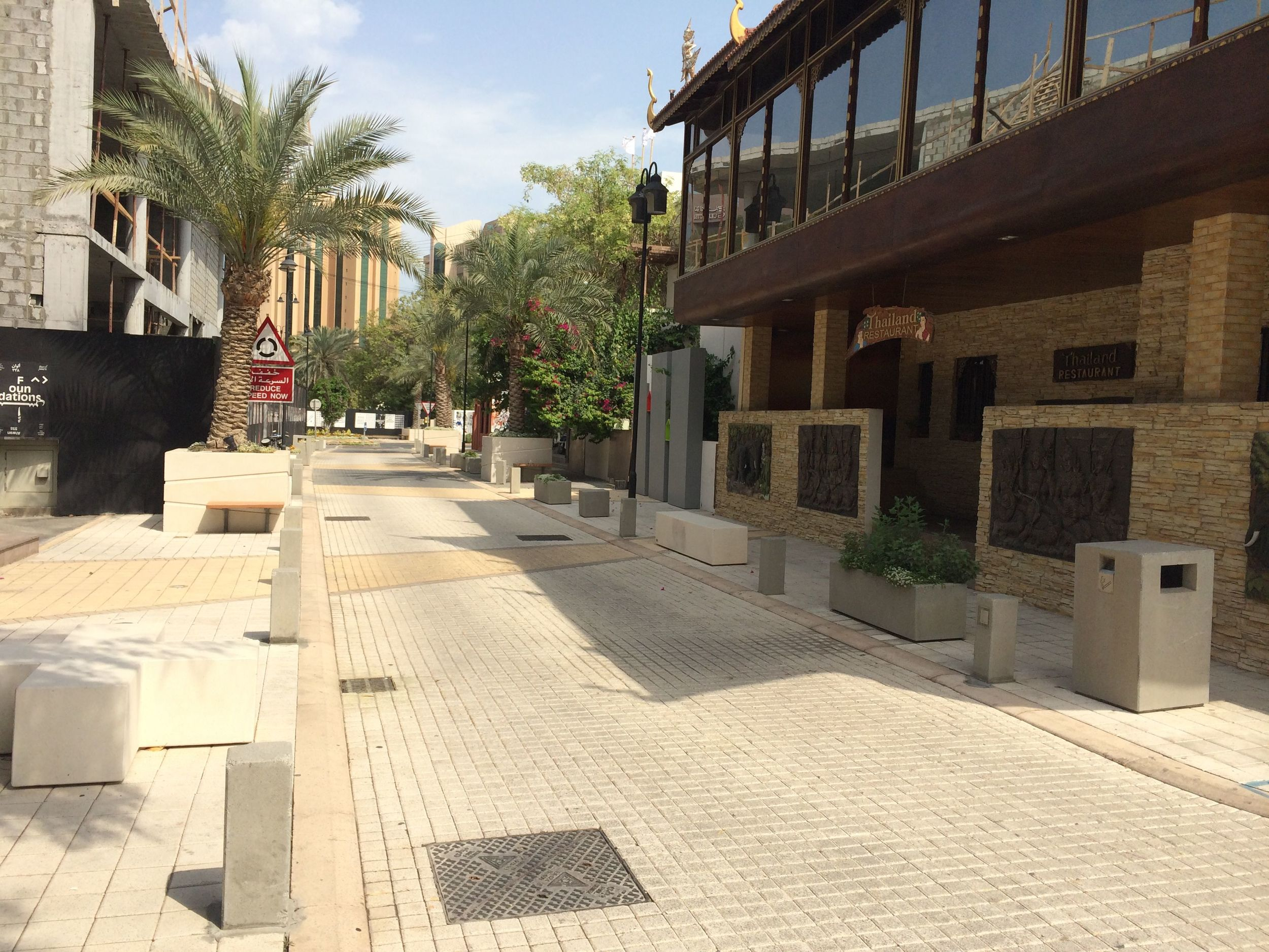 A pedestrian-friendly street in the Adliya neighborhood.