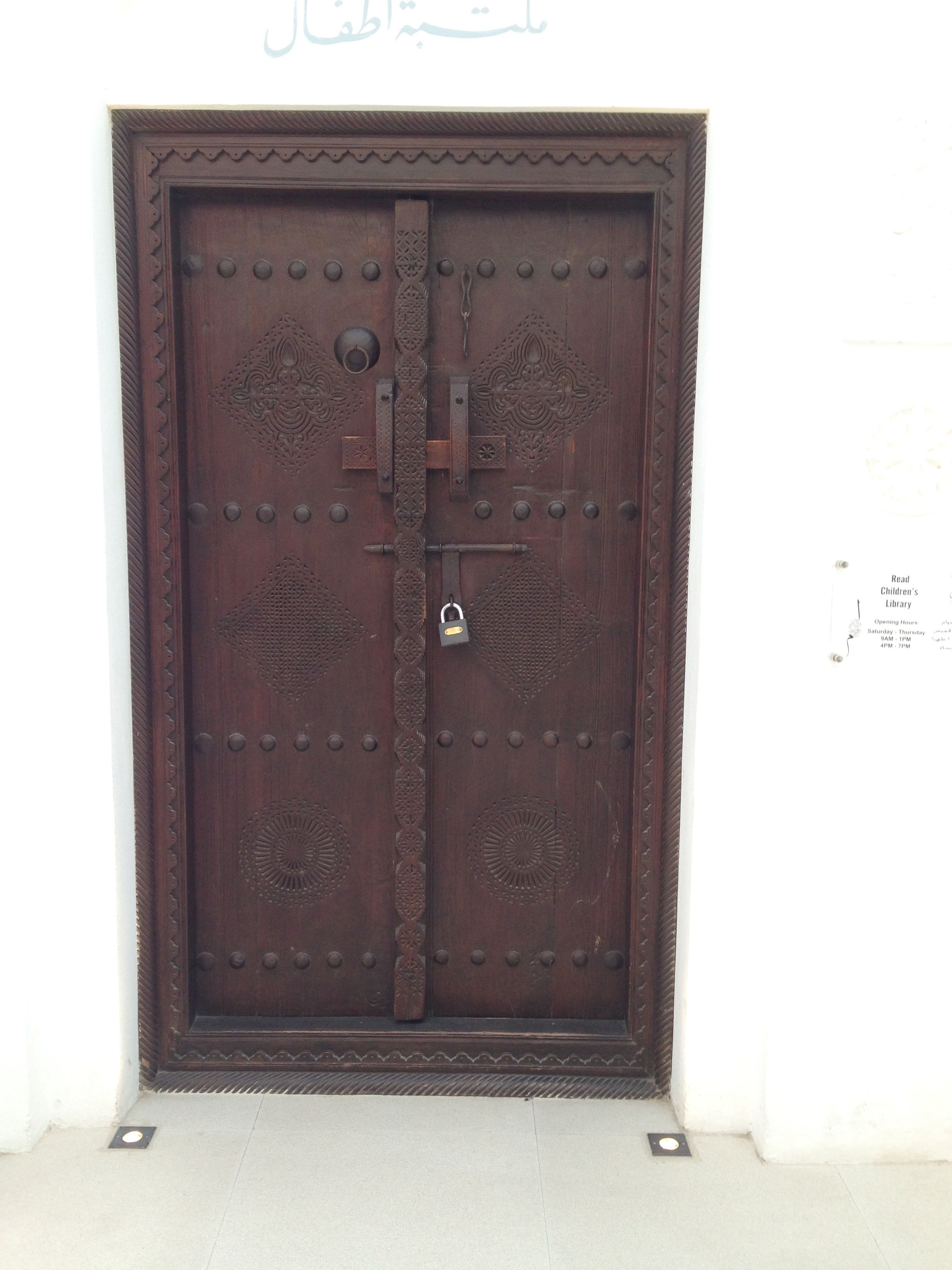 Heavy, carved wooden doors like this and the one below are typical to this style of architecture.