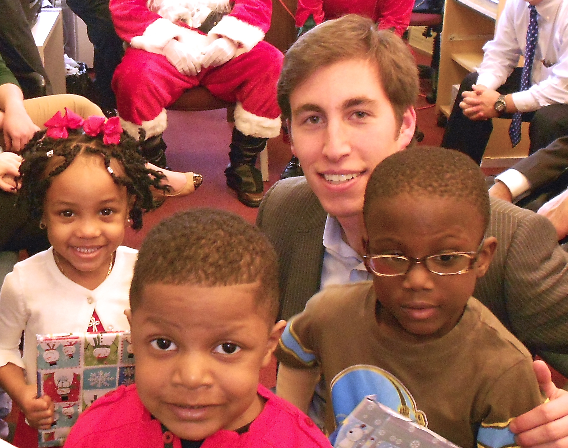 League Board Member, George Ricciardelli, with JFTN preschool children.