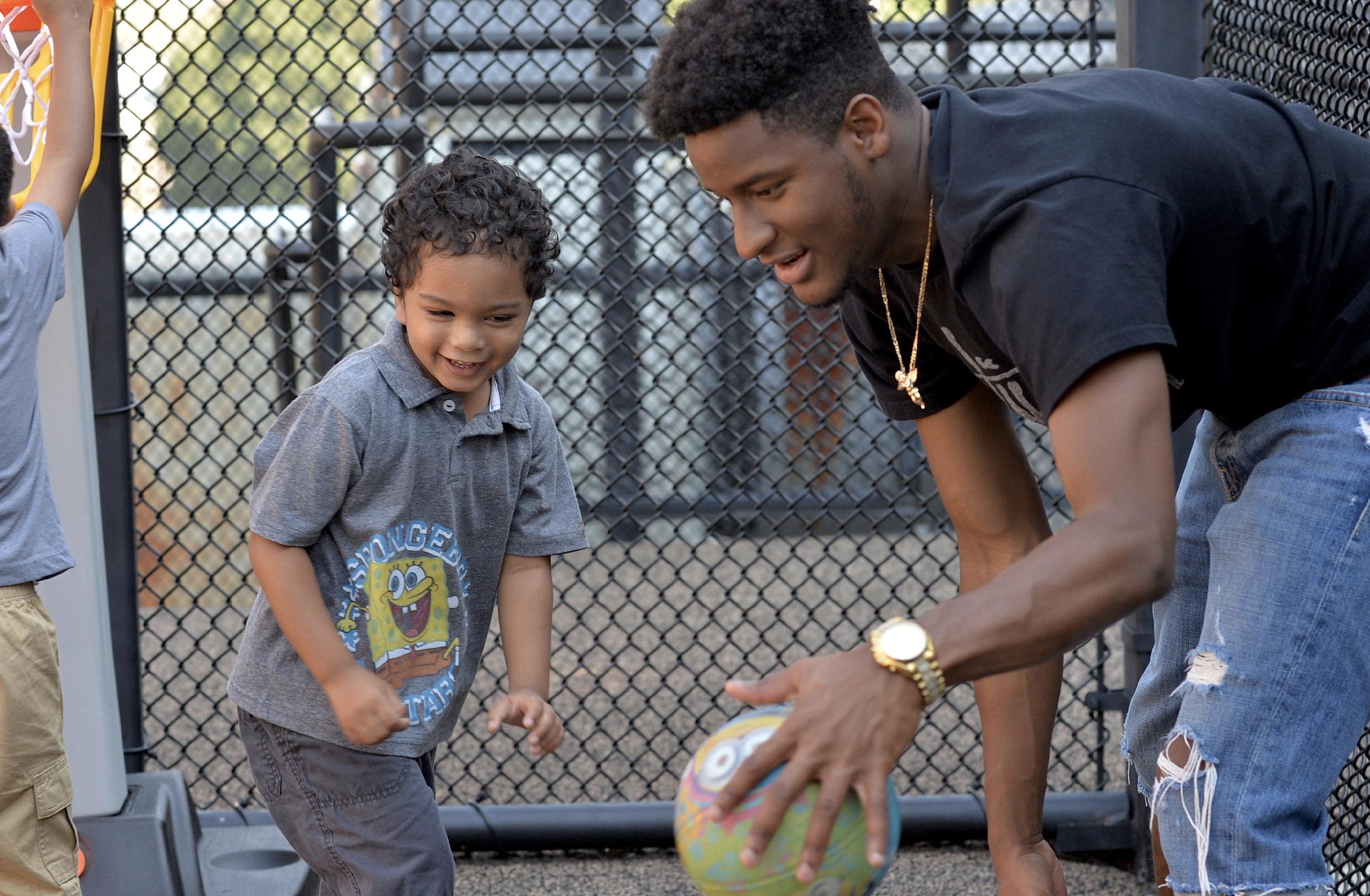 Student and teacher on Brooklyn playground