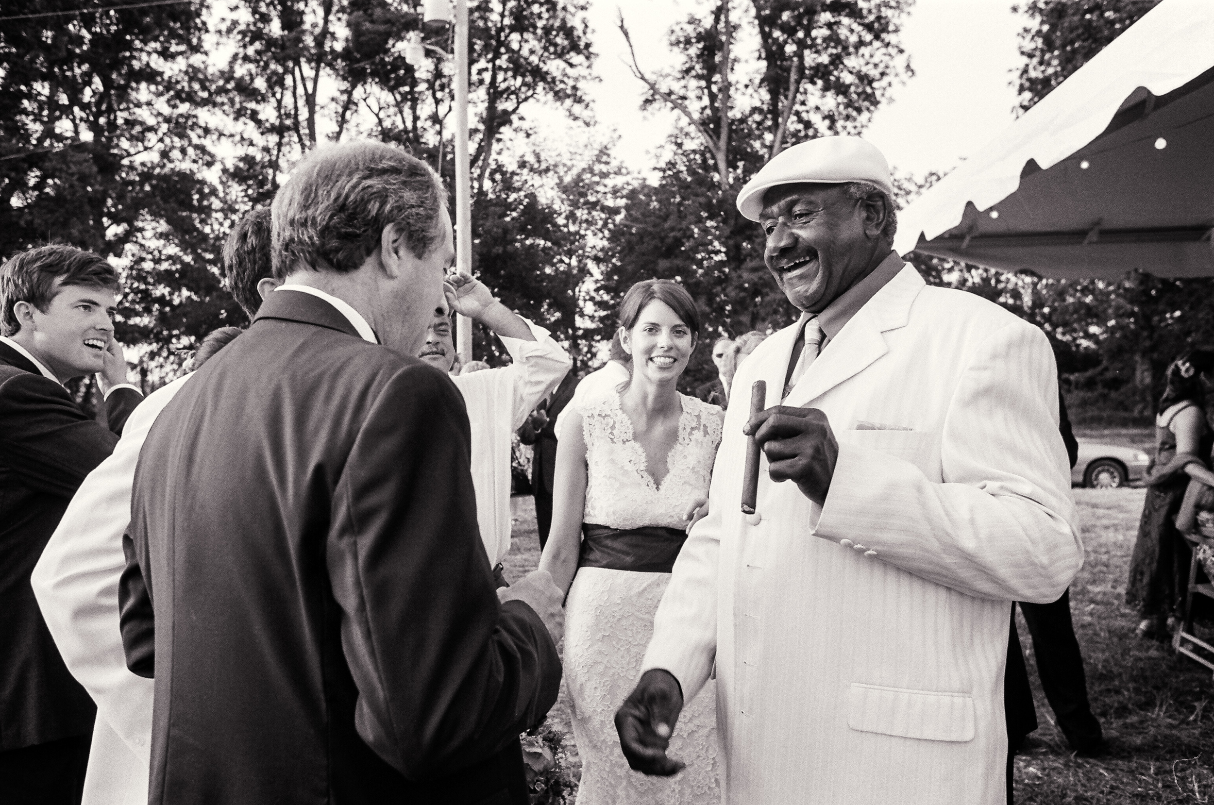 Willie Seaberry (right), aka Po' Monkey, celebrates with guests at Kate (background) and John's wedding in June 2006.