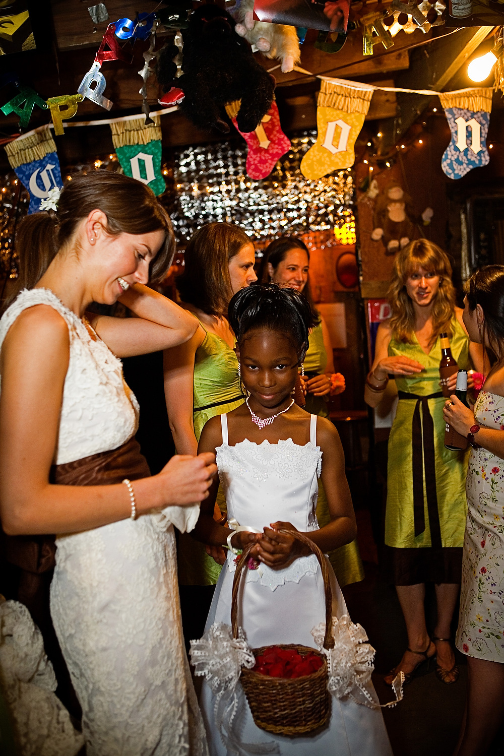 Kate, the bride (left), with Seaberry's granddaughter, an attendant in the wedding (inside the juke joint prior to the start).