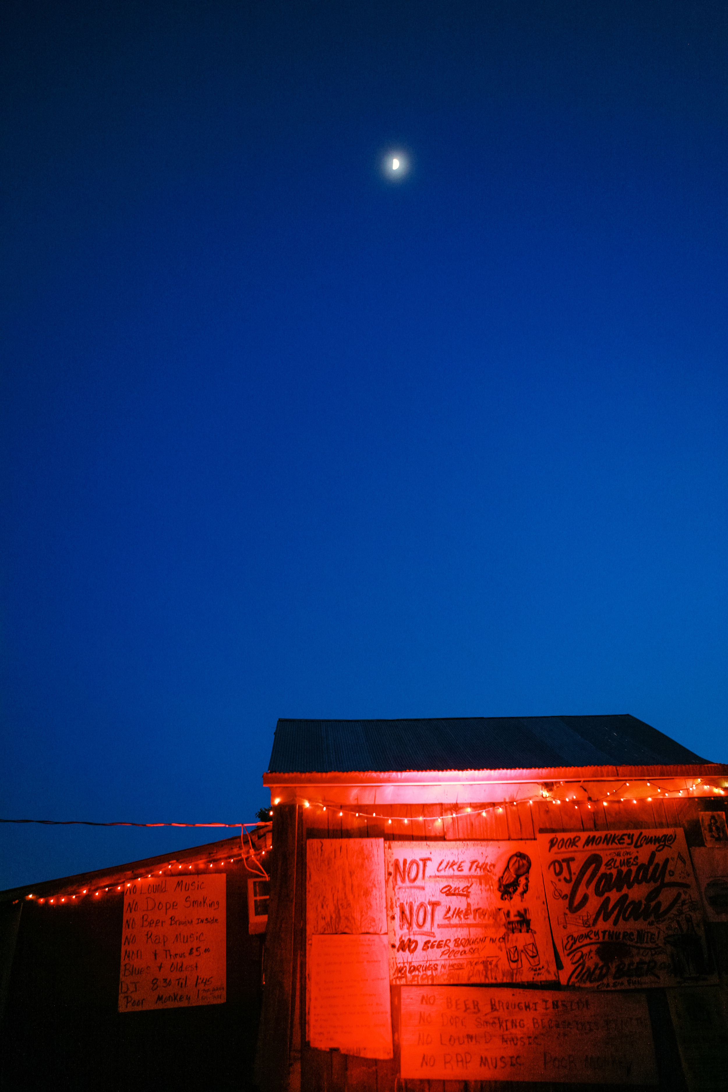 The moon rises above Po' Monkey's juke joint during the night of Kate and John's Mississippi Delta Wedding.