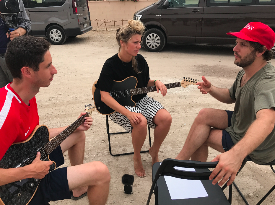 Marit de Jong (center) Getting Lessons From Jason Barrows (right). Pictured with her Moniker Rival Series Guitar.