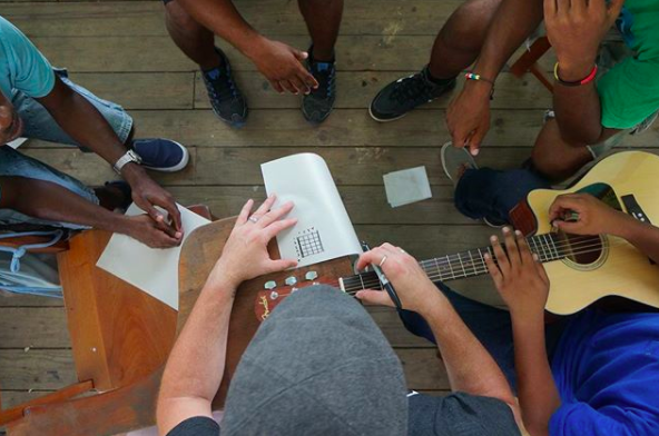 Joshua of Midnight 30 Music teaching in Belize with Guitars For Glory, 2016.