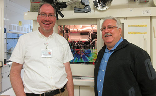 "Researchers Drs. Tim Henrich and Henry VanBrocklin pose at the amfAR Institute for HIV Cure Research at the University of California, San Francisco, in a facility that ""tags"" proteins for later imaging and study."