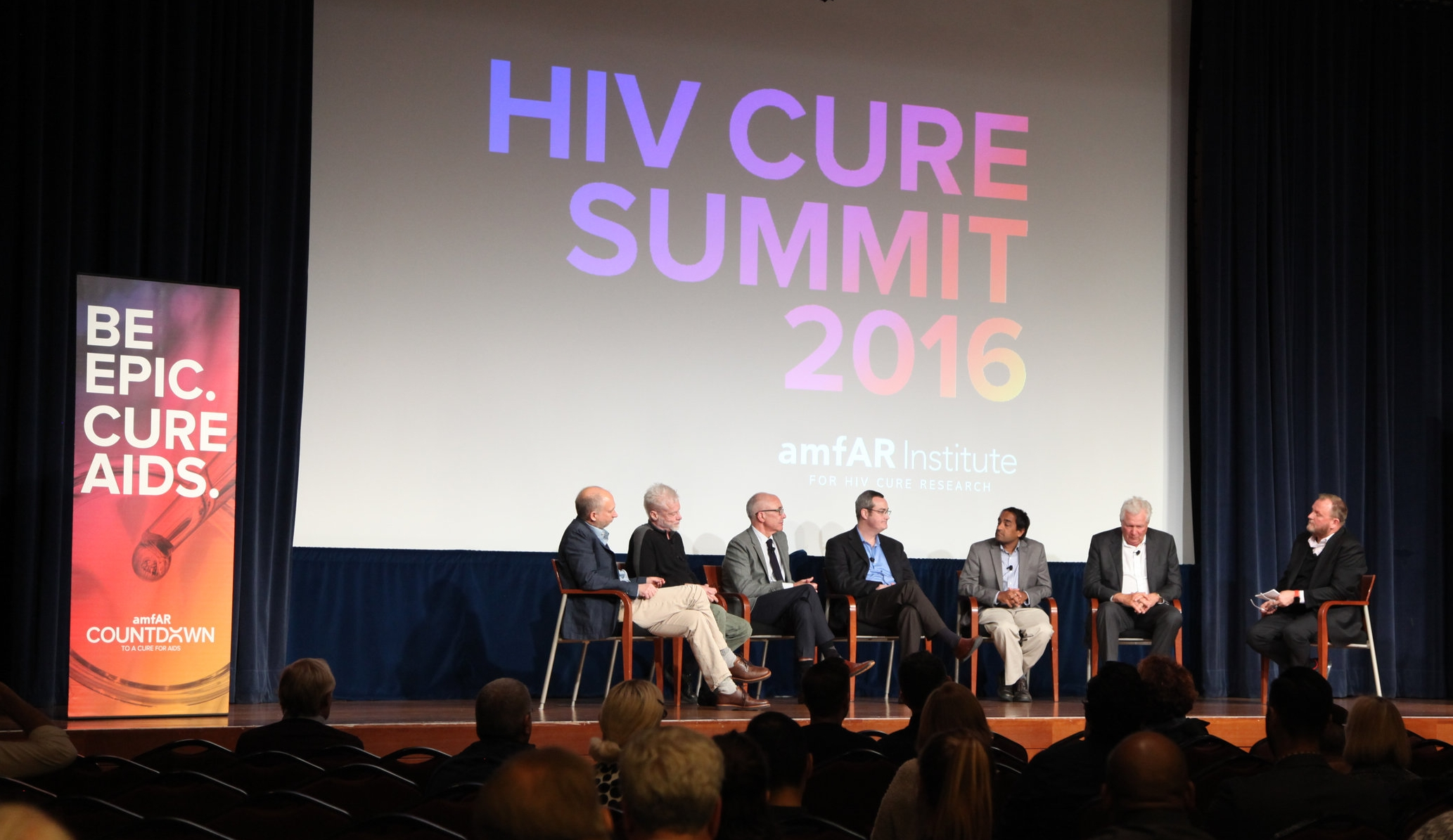 amfAR CEO Kevin Robert Frost (right) moderates the panel discussion.