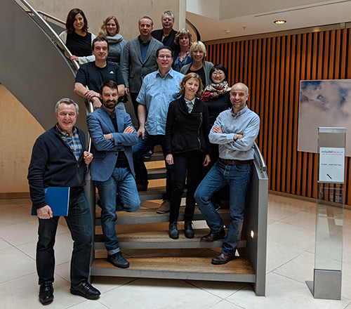 """Co-Principal Investigators Drs. Javier Martinez-Picado (front right) and Annemarie Wensing (center right), pictured with ICISTEM members including Dr. Gero Hütter, """"the Berlin patient's"""" physician, and Dr. Maria Salgado. Also pictured are Dr. Rowena Johnston (front, second from right) and Dr. Jeffrey Laurence (back row, right) of amfAR."""