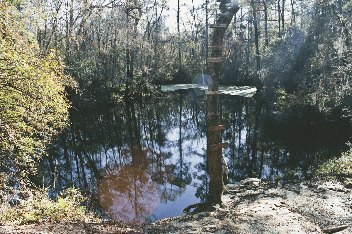 """In the heart of Apalachicola National Forest, FL lies the hidden gem of Leon Sinks Geological Area. Sixty-foot rope swings; 72-degree year round water, and miles of hiking trails make Leon sinks cliché worthy warm weather hang material. Trail maps wait at each trailhead, but print extras depending on your size cooler of beer.     Normal   0           false   false   false     EN-US   X-NONE   X-NONE                                                                                                                                                                                                                                                                                                                                                                    /* Style Definitions */  table.MsoNormalTable {mso-style-name:""""Table Normal""""; mso-tstyle-rowband-size:0; mso-tstyle-colband-size:0; mso-style-noshow:yes; mso-style-priority:99; mso-style-parent:""""""""; mso-padding-alt:0in 5.4pt 0in 5.4pt; mso-para-margin-top:0in; mso-para-margin-right:0in; mso-para-margin-bottom:10.0pt; mso-para-margin-left:0in; line-height:115%; mso-pagination:widow-orphan; font-size:11.0pt; font-family:""""Calibri"""",""""sans-serif""""; mso-ascii-font-family:Calibri; mso-ascii-theme-font:minor-latin; mso-hansi-font-family:Calibri; mso-hansi-theme-font:minor-latin;}"""