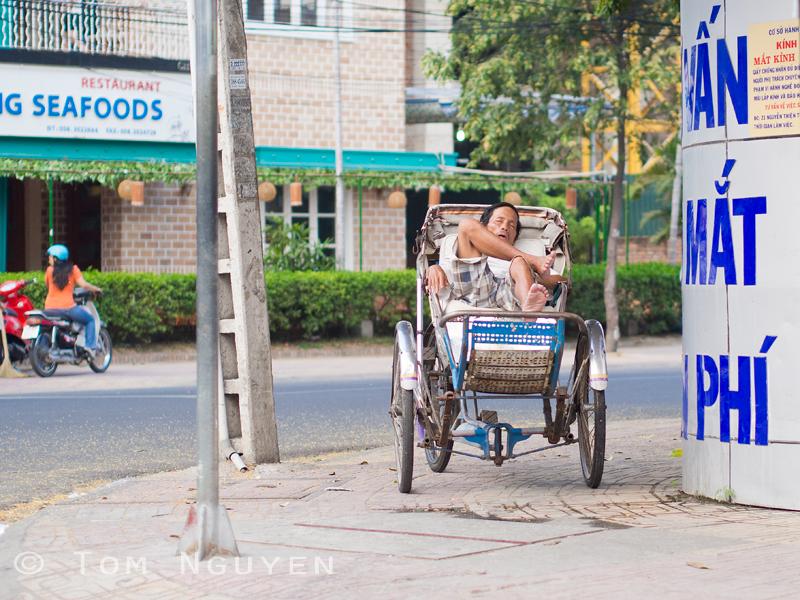 Just snoozing on the job. OMD + 45mm/1.8 lens in Nha Trang, Vietnam.