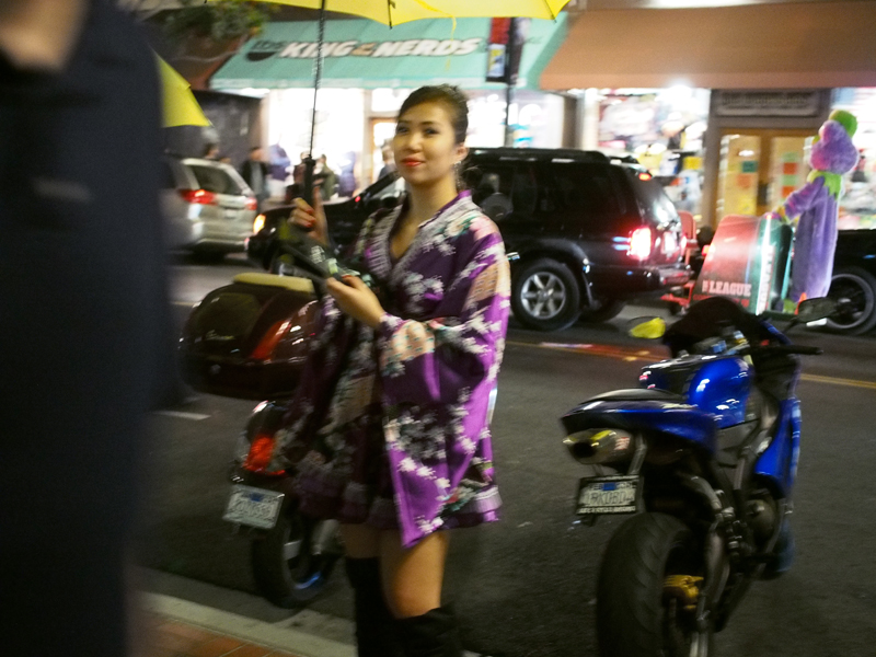 Quick blurry shot. Some dressed up Asian girls promoting a movie called Old Boy Hotel.
