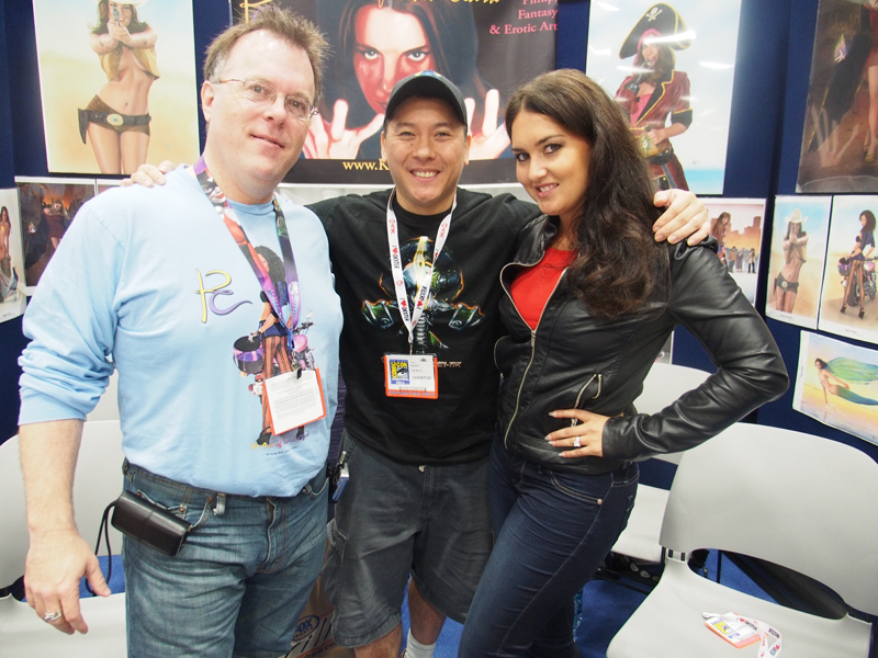 My friend and fellow pinup artist  Kevin Clark  at his table, with his model. Check out his work   here  .