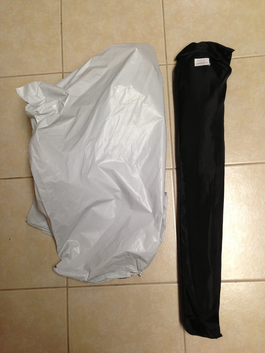 """Out of the plastic bag. The softbox is inside a nice little slip cover """"case"""" made of nylon. It seems straight and undamaged."""