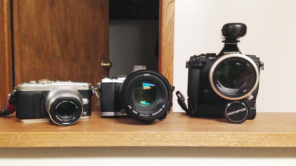 Left to Right: Olympus E-PL5 + 45mm/1.8, Olympus OMD-EM5 + 42.5mm/1.2 Nocticron, and Olympus OMD-EM5 (with battery grip) + 75mm/1.8.