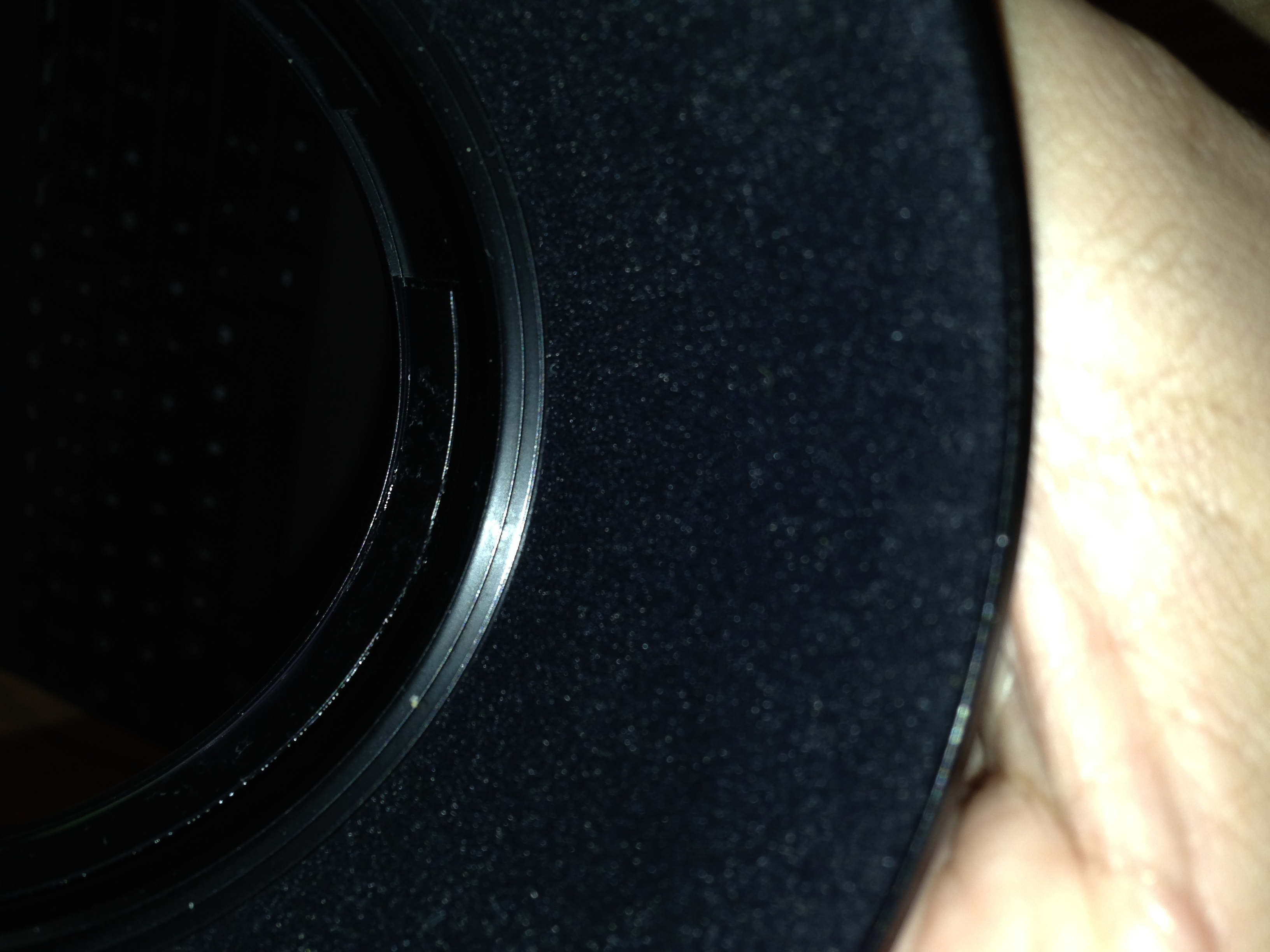 Inside the lens hood. You can see the tightening ring at the rear.