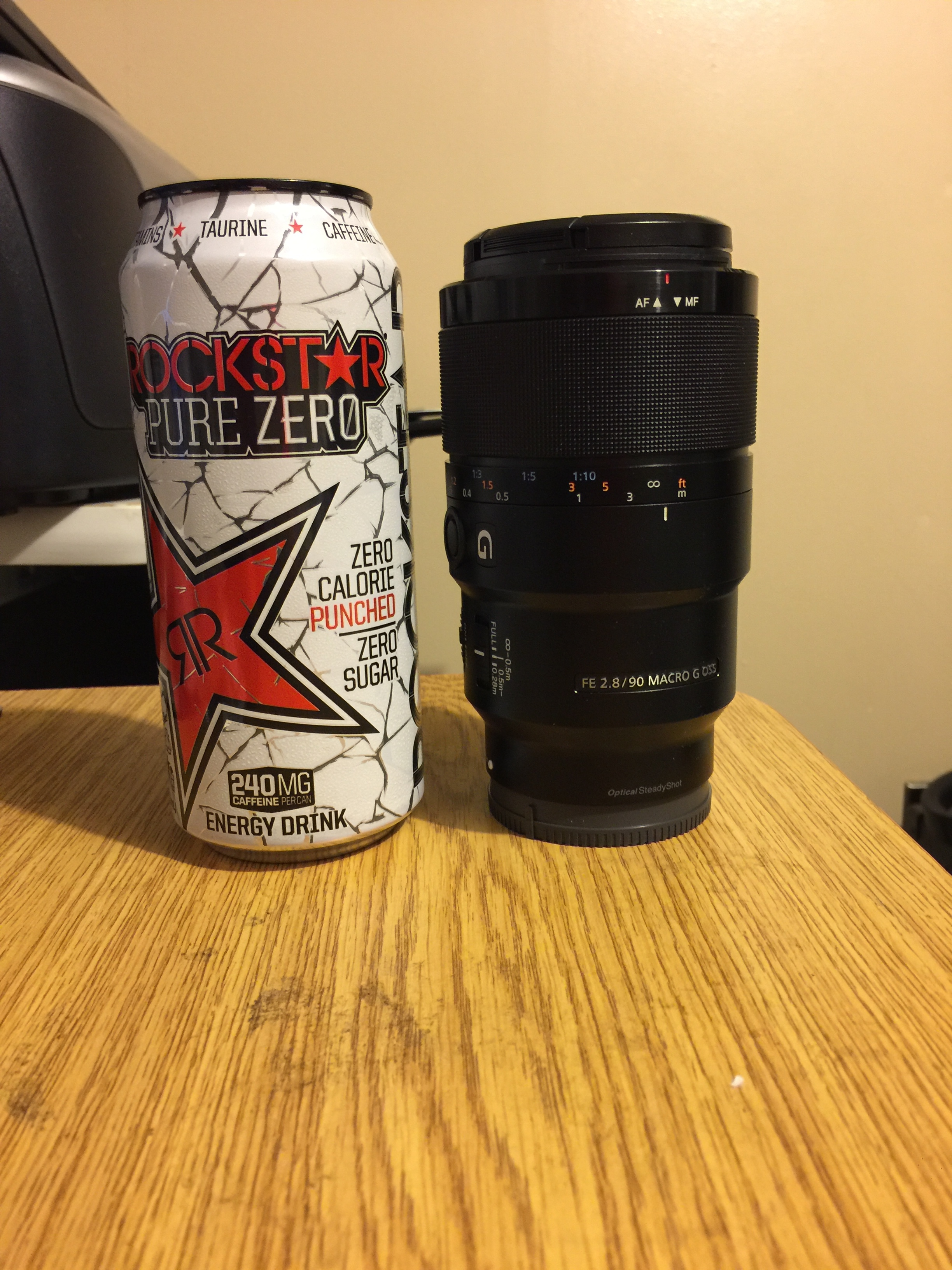 The 90mm/2.8 macro lens is a little shorter and a little thicker than my Rockstar energy drink.  Definitely heavier!