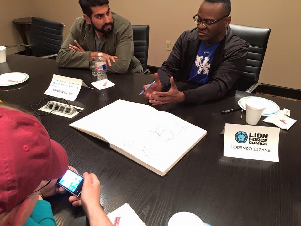Artists Esteban Valdez and Lorenzo Lizana chatting with VIP fans