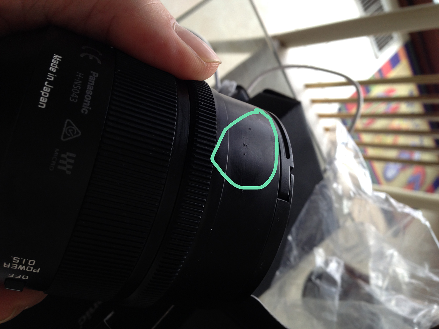 Curiously strange glue mark on the lens barrel.  I wiped it off.
