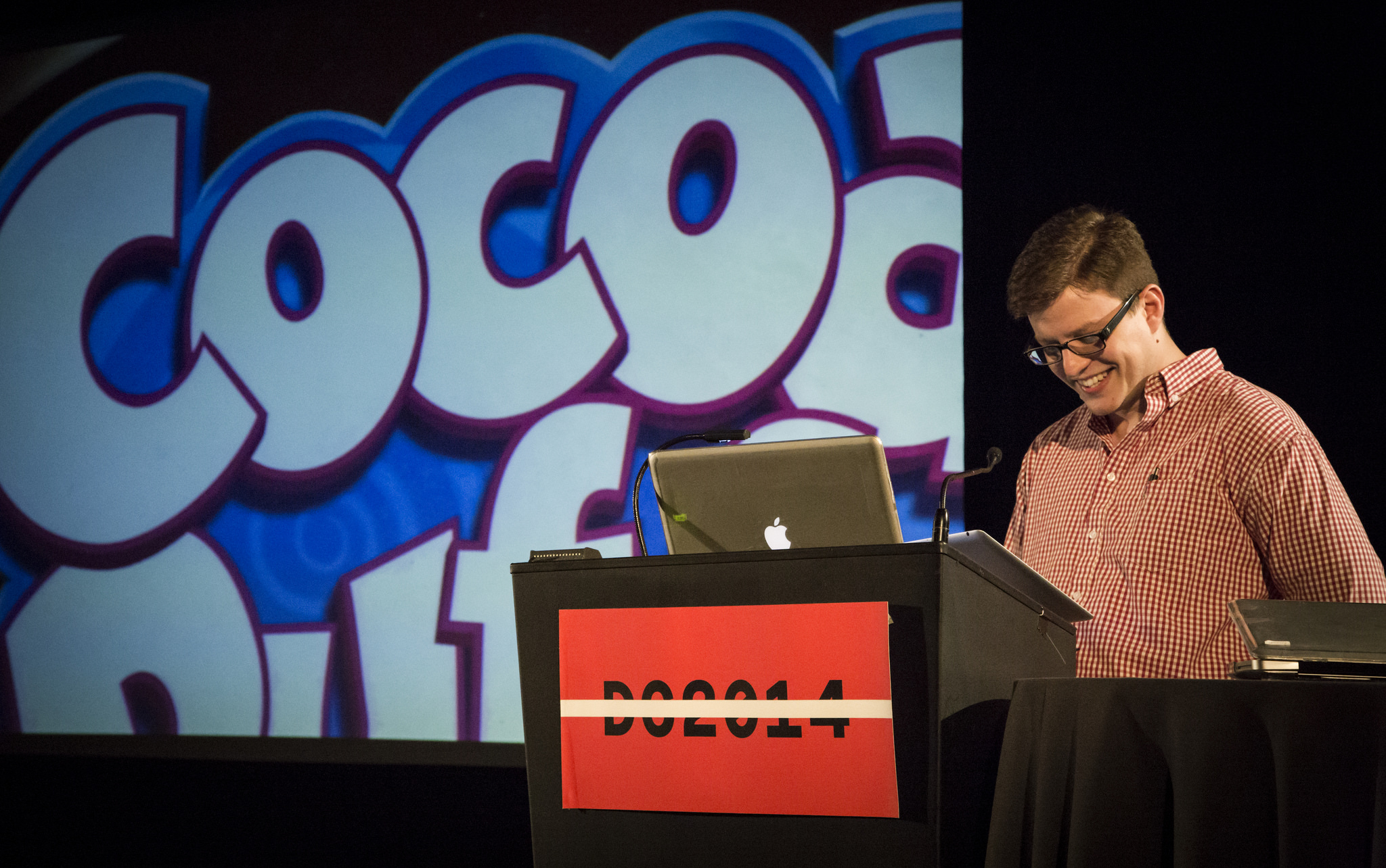 Terrance Weinzierl on stage at TypeCon 2014. Photo by Helen Lysen.