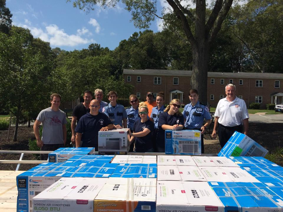 Assisting Plymouth's Chief Bradley and Selectman Tavares to install donated AC units for the elderly (8/2015)