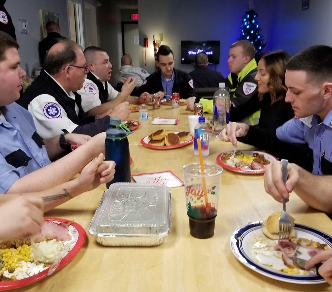 Brewster Ambulance's Taunton team sharing Christmas dinner, 2017