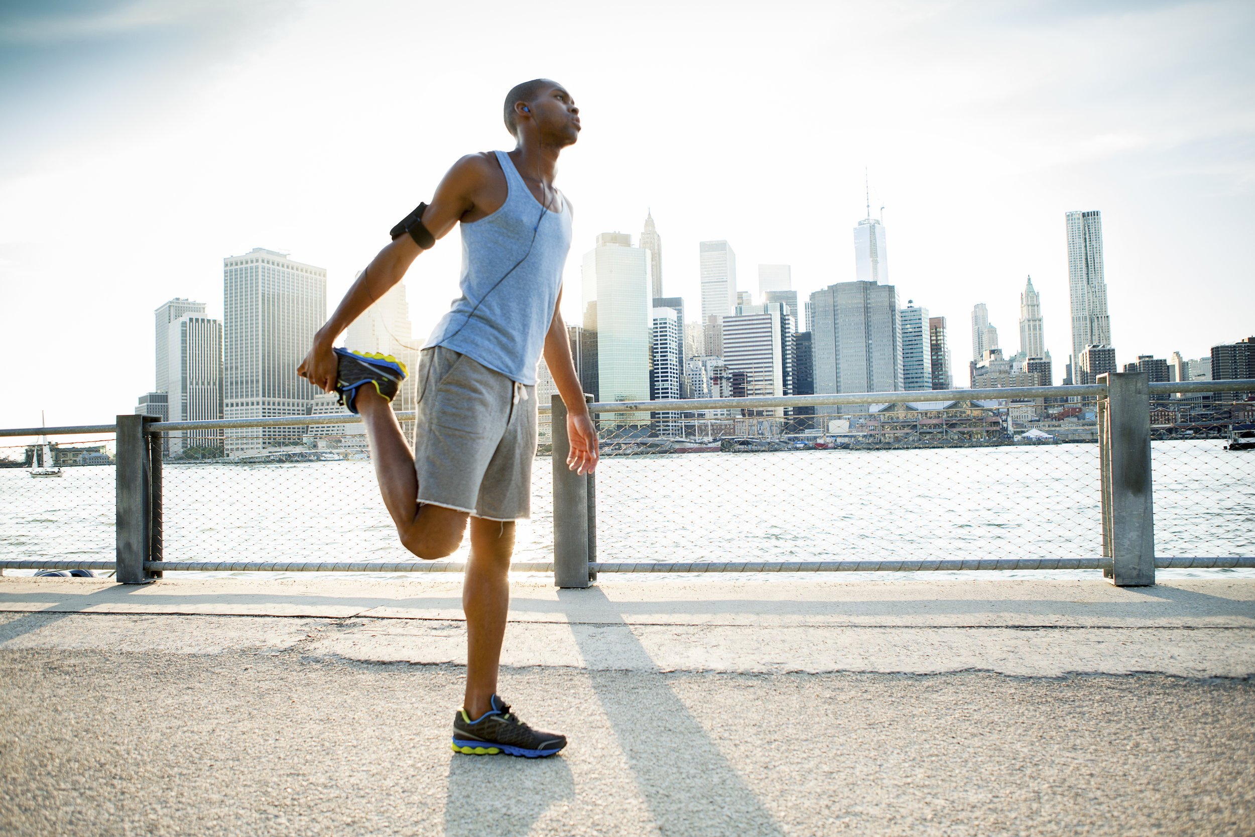 city jogger stretching